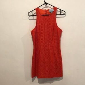 Lace mini dress in beautiful orange/red color.